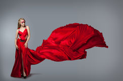 Blonde in windy  dress. Stock Photography