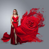 Blonde in windy red  dress. Stock Photos