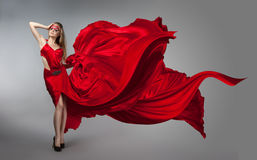 Blonde in windy red and white dress Stock Image
