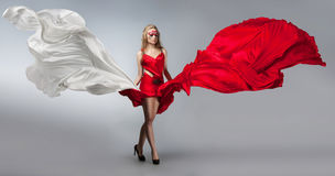 Blonde in windy red and white dress Royalty Free Stock Images