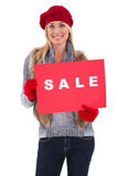 Blonde in winter clothes holding sale sign Stock Images