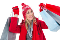 Blonde in winter clothes holding shopping bags Stock Images