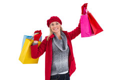 Blonde in winter clothes holding shopping bags Royalty Free Stock Photos