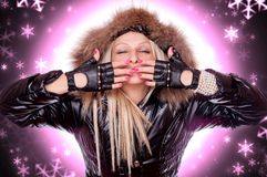 Blonde in the winter jacket sending kisses Stock Images