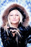 Blonde in the winter jacket sending kisses Stock Photos
