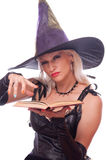 Blonde witch conjuring Stock Photos