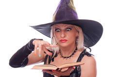 Blonde witch conjuring Royalty Free Stock Images
