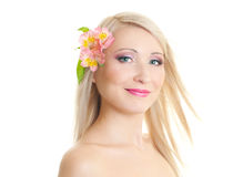 Blonde woman. Beautiful blonde woman with long hair and pink make-up on white background Stock Image