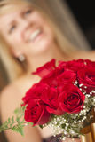 Blonde Woman Accepts Gift of Red Roses Stock Photography