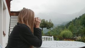 Blonde Woman in the Alps stock footage