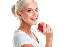 Blonde woman with apple. Diet. Healthy lifestyle. Royalty Free Stock Images