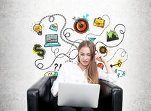 Blonde woman in armchair, business plan, concrete Royalty Free Stock Image