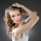 Blonde woman with arms raised, Royalty Free Stock Photos