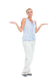 Blonde woman with arms raised in question looking at camera Stock Photos