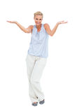 Blonde woman with arms raised in question Stock Photos