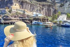 Blonde woman arriving port of Fira in Santorini, Greece stock images