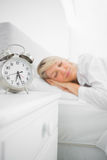 Blonde woman asleep in bed Stock Photography