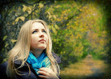 Blonde woman in the autumn park Royalty Free Stock Photos