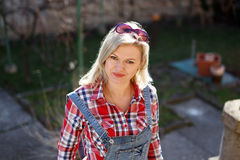 Blonde woman at backyard portrait Royalty Free Stock Image