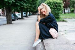 Blonde woman with a bag. Fashion young beautiful blonde woman with a bag. Vogue style royalty free stock image