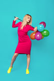Blonde woman with balloons on blue Royalty Free Stock Photos