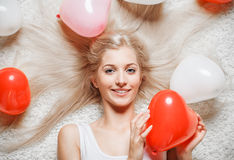 Blonde woman with balloons Stock Photo