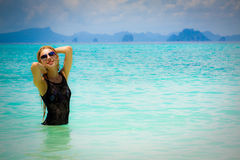 Blonde woman on the beach. Andaman Sea, Thailand Stock Images