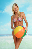 Blonde woman with beach ball Stock Image