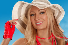 Blonde woman in a beach hat on  the blue sky background Stock Photos