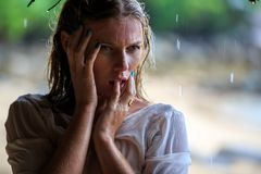 Blonde Woman at the beach Under The Rain Royalty Free Stock Photo