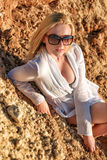 Blonde woman on beach wearing in sunglasses Stock Photography