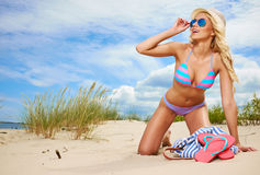 Blonde woman on beach. Royalty Free Stock Image