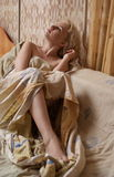 Blonde woman in bed Stock Photography