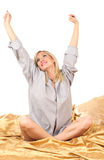 Blonde woman on bed. Studio portrait of young beautifu caucasian blonde woman on bed Stock Images