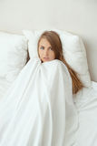Blonde woman in bed Royalty Free Stock Image
