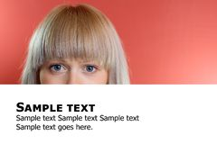 Blonde woman behind billboard with text Royalty Free Stock Images
