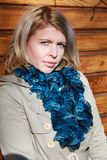 Blonde woman in beige jacket and blue scarf Royalty Free Stock Images