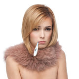 Blonde woman being ill and sad,pink fur collar Royalty Free Stock Image