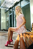 Blonde woman on bench Royalty Free Stock Photo