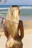 Blonde woman in bikini on beach near sea. Phuket island, Thailand Royalty Free Stock Photo