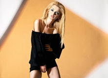 Blonde woman, with black blouse and naked Stock Photo