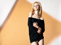Blonde woman, with black blouse and naked Royalty Free Stock Images