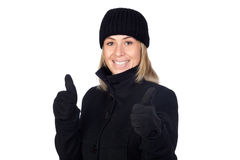 Blonde woman with a black coat saying Ok Stock Photography