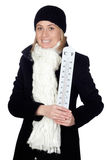 Blonde woman with a black coat and thermometer Royalty Free Stock Photography