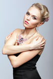 Blonde woman in black dress and necklace Royalty Free Stock Photo
