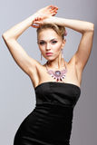 Blonde woman in black dress and necklace Royalty Free Stock Photography