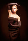 Blonde woman in black dress Royalty Free Stock Photography