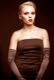 Blonde woman in black dress Royalty Free Stock Image