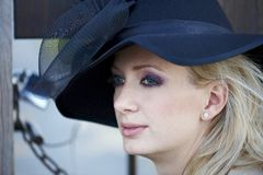 Blonde woman with black hat Stock Photo