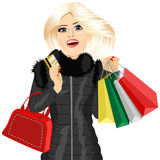Blonde woman in a black winter coat Stock Photography